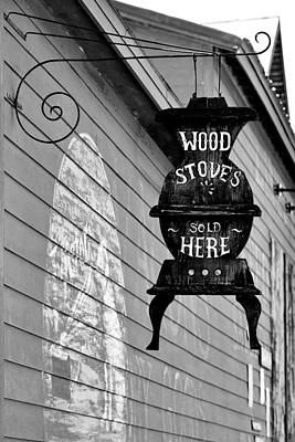 Photograph - Wood Stoves Sold Here by Christine Till
