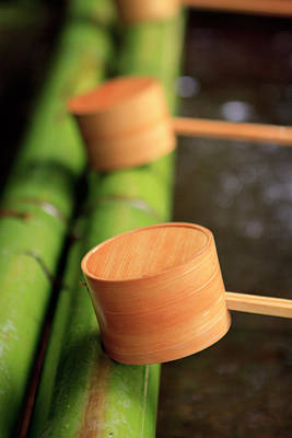 Shinto Temple Photograph - Wooden Ladles Are Placed by Paul Dymond