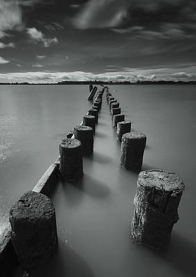 Photograph - Wooden Posts Leading Out Into The River by James Ingham / Design Pics