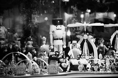wooden toys behind glass window of a stall at spandau christmas market Berlin Germany Print by Joe Fox