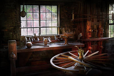 Wagon Wheels Photograph - Woodworker - The Wheelwright Shop  by Mike Savad