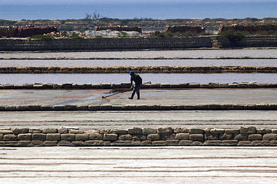 Salt Marsh Photograph - Worker Man At The Salt Industry by Marco Battaglia