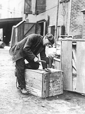 Terminal Photograph - Worker Nailing Boxes by Underwood Archives