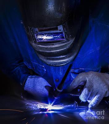 Metal Fabrication Photograph - Worker Welding The Steel Part by Anek Suwannaphoom
