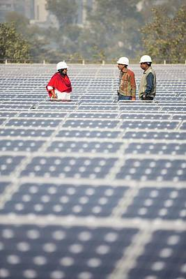 Workers At A 1 Mw Solar Power Station Art Print by Ashley Cooper