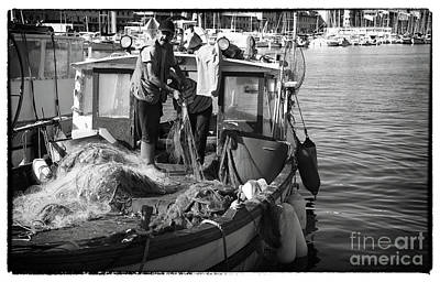 Artist Working Photograph - Working The Nets by John Rizzuto