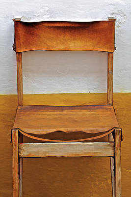 Photograph - Worn Leather Outdoor Cafe Chair  by David Letts