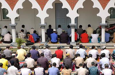 Photograph - Worshipers At Friday Prayers - Masjid Jame - Friday Mosque - Kuala Lumpur - Malaysia by David Hill