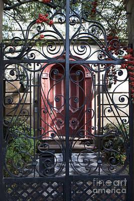 Jason O. Watson Photograph - Wrought Iron Gate And Red Door Charleston South Carolina by Jason O Watson