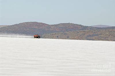 Ford Falcon Coupe Photograph - Xb Ford Falcon Coupe On The Salt At Full Throttle by Frank Kletschkus