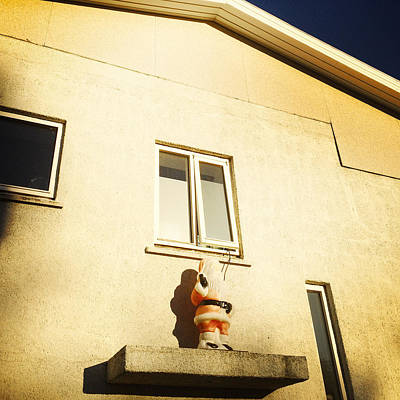 House Photograph - Xmas Decoration With Santa In June Akureyri Iceland by Matthias Hauser