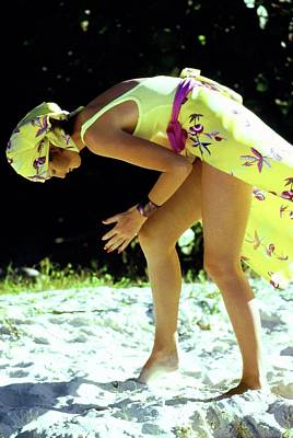 Photograph - Yasmine Sokal Wearing A Yellow Ensemble by Arthur Elgort