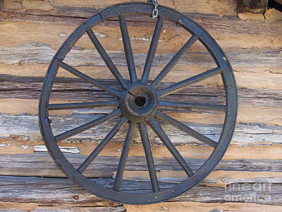 Photograph - Yates Mill Wagon Wheel by Kevin Croitz