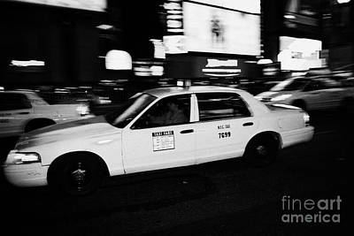 Yellow Cab In Times Square At Night New York City Art Print by Joe Fox