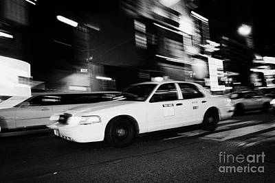 Yellow Cab New York City At Night Art Print by Joe Fox