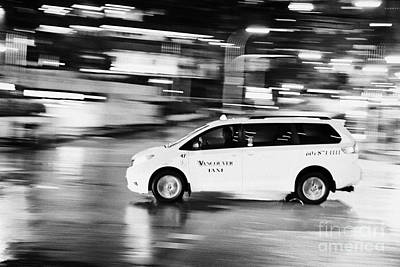 yellow cab taxi downtown Vancouver city at night BC Canada deliberate motion blur Art Print by Joe Fox