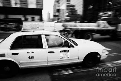 Yellow Cab With Advertising Hoarding Blurring Past Crosswalk And Pedestrians New York City Usa Art Print by Joe Fox
