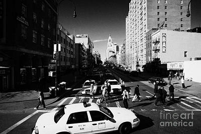 yellow cabs and pedestrians on crosswalk at junction of 1st Avenue and east 14th street st new york Art Print by Joe Fox