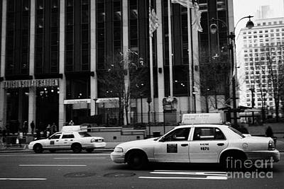 Fast Taxi Photograph - Yellow Cabs Blur Past Madison Square Garden On 7th Avenue New York City by Joe Fox