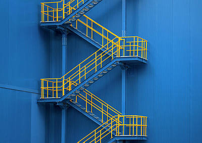 Photograph - Yellow Metal Staircase Against A Blue by Ozgur Donmaz