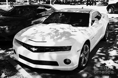 Fifth Generation Photograph - Yellow Ss V8 Chevy Camaro Parked On Street In Celebration Florida Usa by Joe Fox