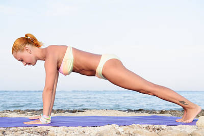 Sports Royalty-Free and Rights-Managed Images - Yoga practice - Slim woman practicing plank pose by Nikita Buida