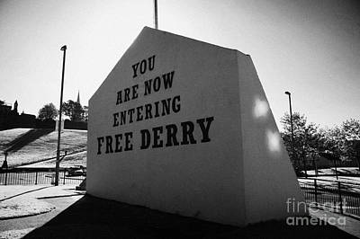 you are now entering free derry gable wall painting with petrol bomber mural in the background at free derry corner in the bogside area of Derry Londonderry Art Print