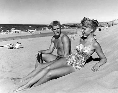 One Piece Swimsuit Photograph - Young Adults On A Beach by Underwood Archives