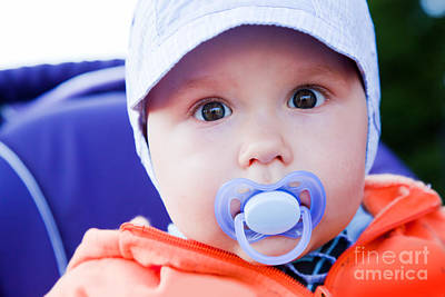 Face Photograph - Young Baby Boy With A Dummy In His Mouth Outdoors by Michal Bednarek