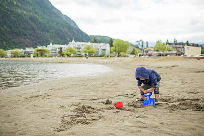 Harrison Hot Springs Wall Art - Photograph - Young Boy Playing On Beach, Harrison by Christopher Kimmel