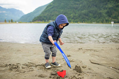 Harrison Hot Springs Wall Art - Photograph - Young Boy Playing On Sandy Beach by Christopher Kimmel
