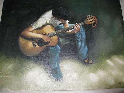 Young Boy Playing The Guitar Art Print