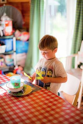 Table Setting Photograph - Young Boy Setting The Table At Home by Samuel Ashfield