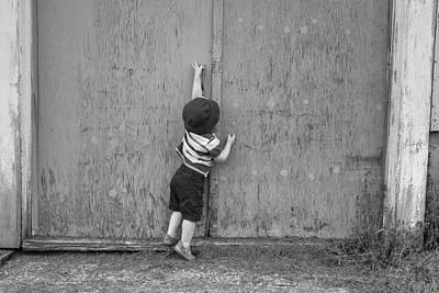 Farnham Photograph - Young Boy Trying To Open Barn Door by David Chapman