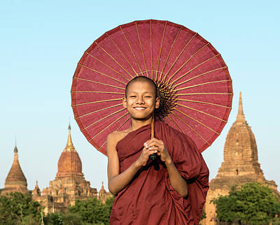 Photograph - Young Buddhist Monk Holding Traditional by Martin Puddy