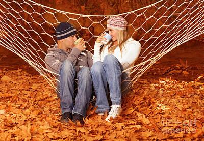 Young Couple Drink Tea In Hammock Art Print