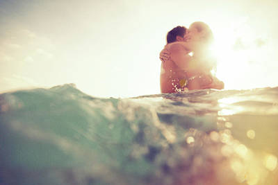 Photograph - Young Couple Having Fun In The Sea by Nullplus