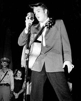 Movie Star Photograph - Young Elvis Presley Stands Over Microphone by Retro Images Archive