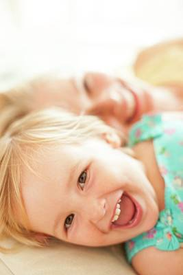 Young Girl Lying Down Laughing Art Print