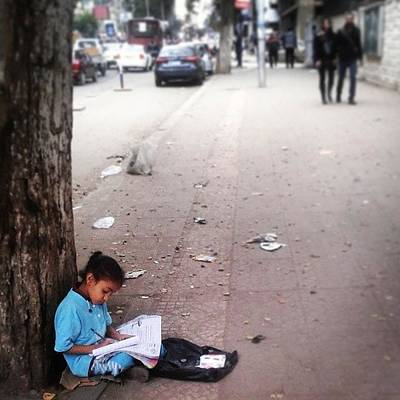 Young Girl Photograph - #young #girl #studing #while #selling by Hema Ezzat