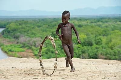 Young Karo Boy With Home Made Toy Hoop Art Print by Tony Camacho