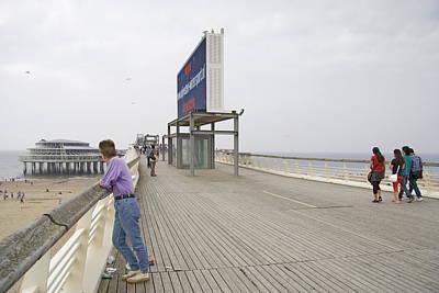 Scheveningen Pier Photograph - Young Lady On The Pier In Scheveningen Netherlands by Ronald Jansen