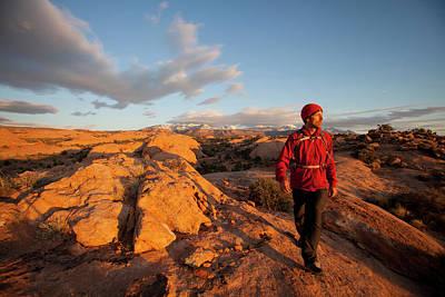 Slickrock Photograph - Young Man Hiking On Slickrock by Justin Bailie