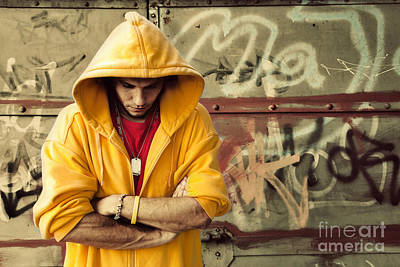 Artistic Hooded Portrait Photograph - Young Man In Hooded Sweatshirt On Grunge Wall by Michal Bednarek