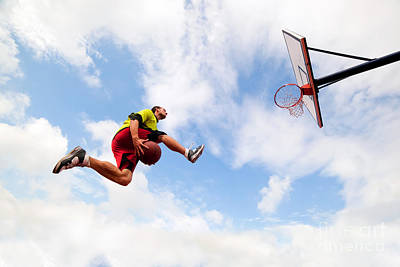 Action Photograph - Young Man Making A Fantastic Slam Dunk Playing Streetball Basketball by Michal Bednarek