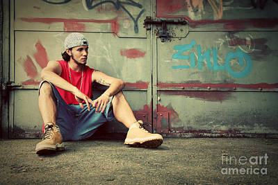 Man Photograph - Young Man Sitting Grunge Graffiti Wall by Michal Bednarek