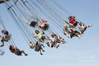 Photograph - People On A Swing Carousel At A County Fair by William Kuta
