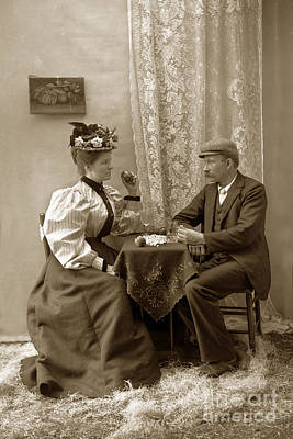 Photograph - Young Victorian Couple Sitting At A Table Circa 1910 by California Views Archives Mr Pat Hathaway Archives