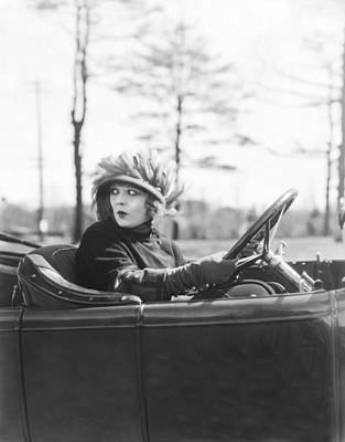 Uncertainty Photograph - Young Woman At The Wheel by Underwood Archives