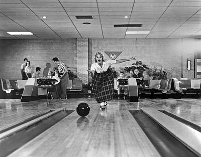 Photograph - Young Woman Bowling by Underwood Archives